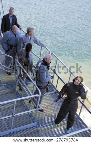 FREDERICIA, DENMARK - MAY 10, 2015: Bridgewalking Littlebelt. Official opening day. Crown Princess Mary and Bridgewalkingchef, Knud Jeppesen ,Tanja Doky, Mayor Steen Dahlstroem and Jacob Bjerregaard. - stock photo
