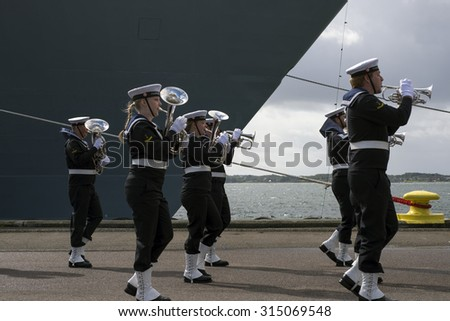 FREDERICIA, DENMARK - SEPTEMBER, 5: Royal Danish Navy Band in front of Danish warship, HDMS Iver Huitfeldt (F361) adopted by the municipality of Fredericia, 5th.September 2015.  - stock photo