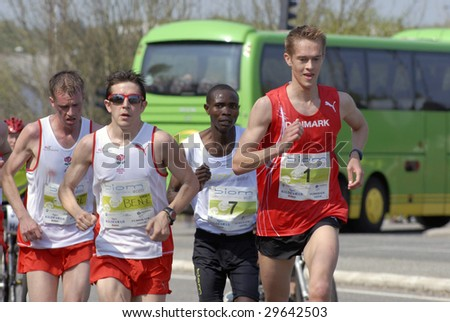 FREDERICIA - MAY 2: Leading male group passing 14 km. Little Belt Half Marathon. David Kidet (number 7) vinner of the race and runner up Jesper Faurschou ( number 1). 2nd of May, 2009. Denmark. - stock photo