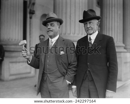 Frederick Gillette, leaving his position as Speaker of the House of Representative for a Senate seat, hands his gavel to Nicholas Longworth, the new Speaker. Feb. 28, 1925. - stock photo