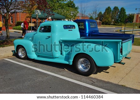 FREDERICK, MD- SEPTEMBER 16: Blue Vintage Ford Truck on Sept. 16, 2012 in Frederick , MD USA. Alzheimer's Association Benefit Car Show at Motor Vehicle Administration in Maryland. - stock photo