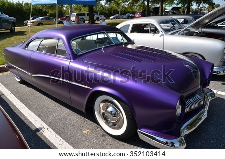 FREDERICK, MD - SEPTEMBER 16 : 1950 Purple Ford Coupe Frontal Design Detail at a Car Show on September 16, 2015 in Frederick, MD USA. A Alzheimer's Benefit Car Show to fund research in Maryland. - stock photo