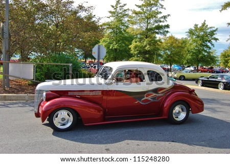 FREDERICK, MD- SEPTEMBER 16: Unidentified Man driving a 1939 Red, and White Chevy Coupe on Sept. 16, 2012 in Frederick , MD USA. Alzheimer's Association Benefit Car Show at MVA in Maryland - stock photo