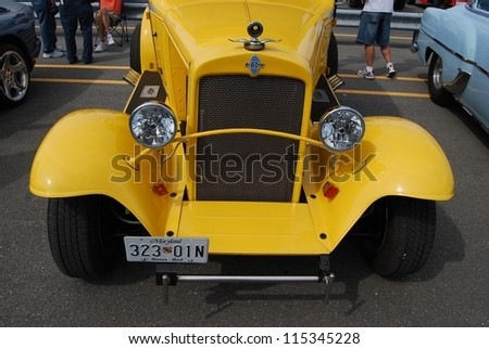 FREDERICK, MD- SEPTEMBER 16: 1962 Yellow Ford Coupe Front View, and Engine on Sept. 16, 2012 in Frederick, MD USA. Alzheimer's Association Benefit Car Show at MVA in Maryland. - stock photo