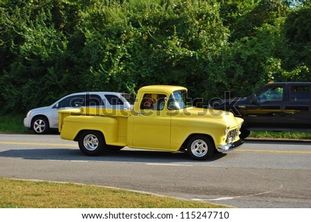 FREDERICK, MD- SEPTEMBER 16: Yellow Vintage Ford Truck  on Sept. 16, 2012 in Frederick , MD USA. Alzheimer's Association Benefit Car Show at Motor Vehicle Administration in Maryland. - stock photo