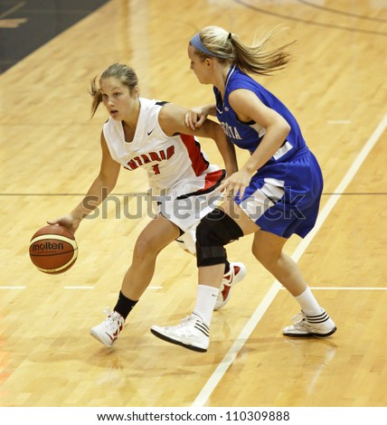 FREDERICTON, CANADA - AUGUST 11: Ontario's Bridget Atkinson dribbles against N.S. in the Canadian 17U women's basketball championship game Aug. 11, 2012 in Fredericton, Canada. Ontario won 66-48. - stock photo