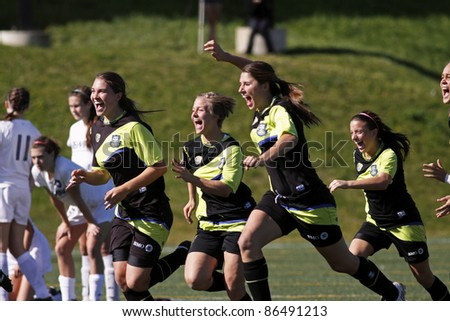 FREDERICTON, CANADA - OCTOBER 10: Unidentified Longueuil, Que., celebrates their gold-medal game win against North London, Ont., at the Canada Soccer U18 championships on Oct. 8, 2011 in Fredericton, Canada. - stock photo