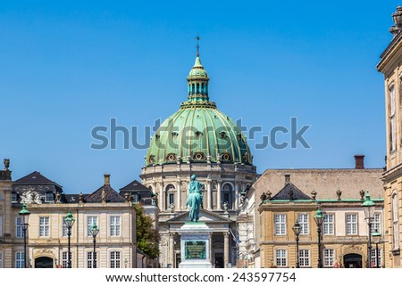 Frederik's Church, popularly known as The Marble Church and castle Amalienborg with statue of Frederick V in Copenhagen, Denmark - stock photo