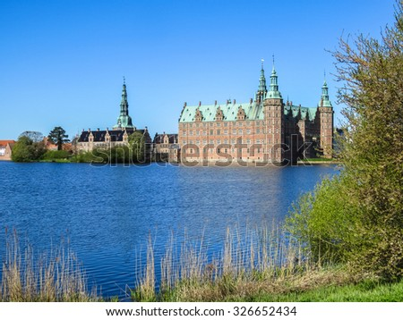 Frederiksborg Slot - Royal Castle is situated in Hillerod, Denmark - stock photo