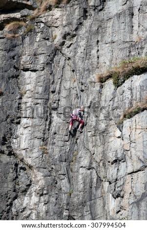 Free climber on the wall - stock photo