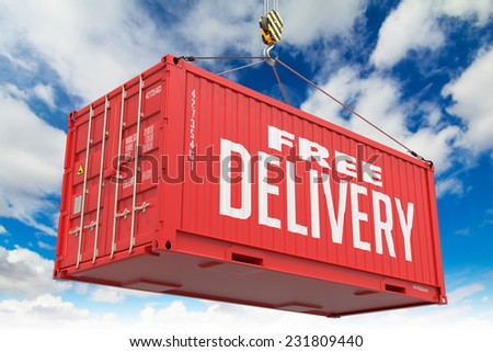 Free Delivery - Red Hanging Cargo Container on Sky Background. - stock photo
