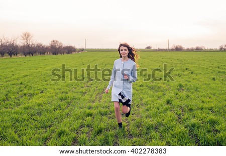 free happy female in field enjoying the sunset