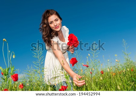 Free Happy Woman Enjoying Nature. Beauty Girl Outdoor. Freedom concept. Beauty Girl over Sky and Sun.Enjoyment.  - stock photo