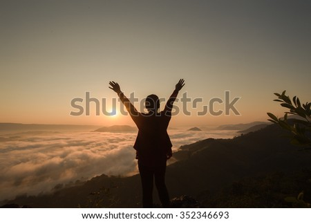 Free Happy Woman Enjoying Nature. Beauty Girl Outdoor. Freedom concept. Beauty Girl over Sky and Sun. Sunbeams. Enjoymen