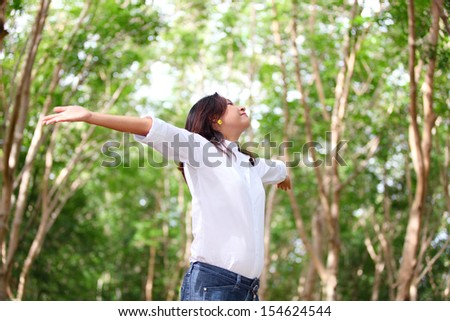 Free Happy Woman Enjoying Nature. Beauty Girl Outdoor. Freedom concept. . Enjoyment - stock photo