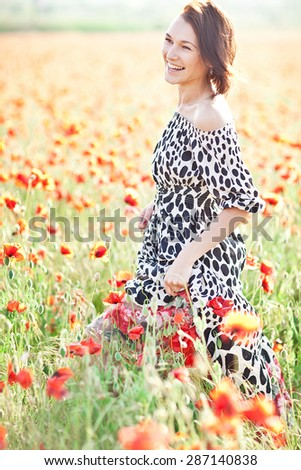 Free Happy Woman Enjoying Nature. Beauty Girl Outdoor. Freedom concept.  Sunbeams. Enjoyment. Dreaming. Summer Mood - stock photo
