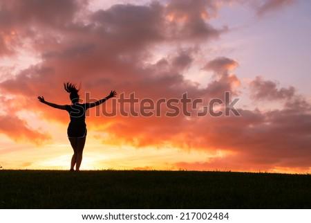 Free happy woman enjoying nature. Freedom concept. Enjoyment. Sunbeams - stock photo