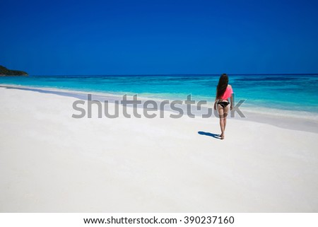 Free Happy Woman Enjoying tropical beach, girl walking on exotic beach with white sand and blue water. Travel. Vacation. Lifestyle. Bliss freedom concept.