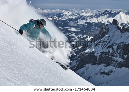 Free ride skier turns in powder snow. - stock photo