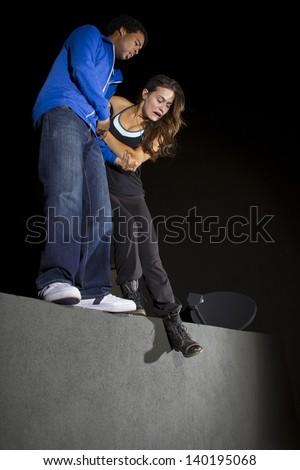 free runner getting ready to do parkour at night - stock photo