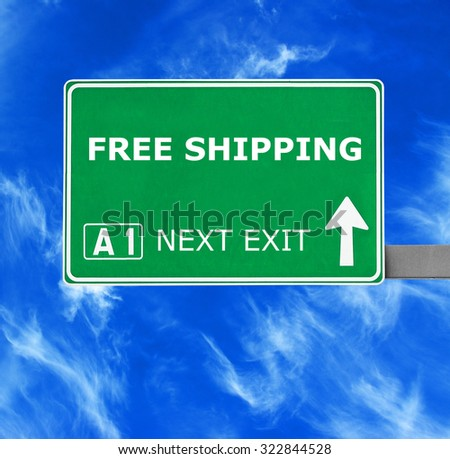 FREE SHIPPING road sign against clear blue sky
