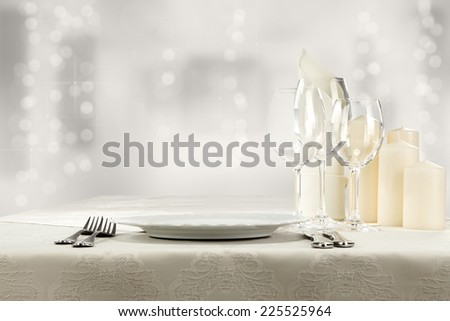 free space on plate and glasses with light of xmas  - stock photo