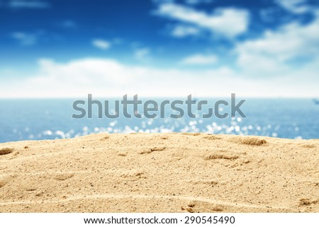 free space on warm yellow sand and blue summer sea  - stock photo