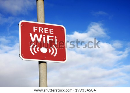 Free WiFi sign against a blue sky - stock photo