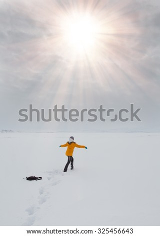 Free woman running on the snowy road