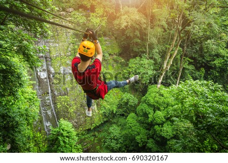 Freedom adult Man Tourist Wearing Casual Clothing On Zip Line Or Canopy Experience In Laos Rain & Canopy Stock Images Royalty-Free Images u0026 Vectors | Shutterstock