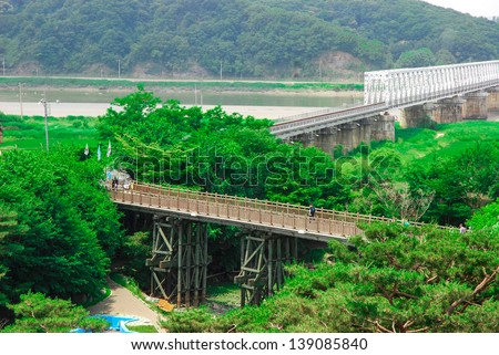 "Freedom bridge DMZ, Korea. The Bridge of Freedom got its name when 13,000 war prisoners shouted ""Hurray Freedom!"" as they returned home crossing the bridge following the Armistice Agreement in 1953. - stock photo"