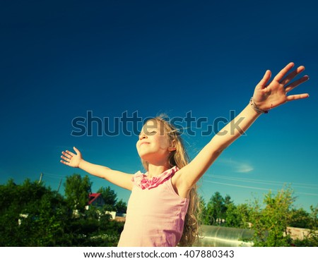 Freedom. Child with outstretched arms