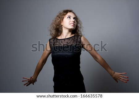 Freedom concept. Free woman smiling happy with arms raised joyful Beautiful young girl Caucasian girl in her 20s. - stock photo