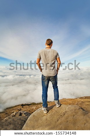 freedom concept: man on the peak of mountain