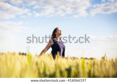 freedom, happiness, inspiration, stroll, beautiful girl in the field, wheat field, green wheat, summer, sunlight