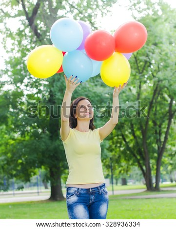 Freedom,Happy, Carefree, Relax, Young Woman with Colorful Balloons at beautiful Summer Day Outdoor. Attractive female enjoying nature. - stock photo