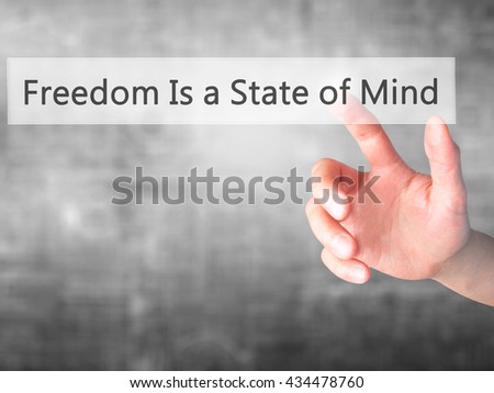Freedom Is a State of Mind - Hand pressing a button on blurred background concept . Business, technology, internet concept. Stock Photo - stock photo