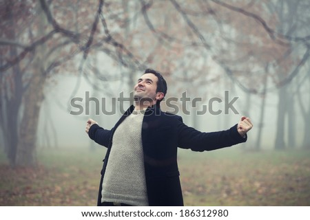Freedom - Man with arms outstretched - stock photo