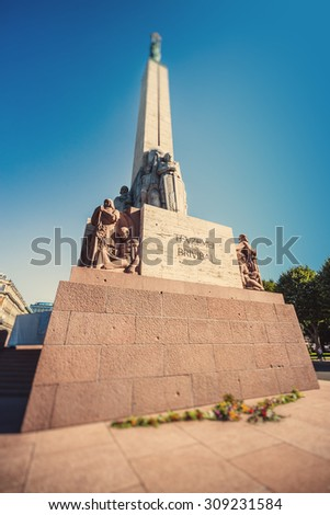Freedom Monument known as Milda, located in the centre of Riga, the capital of Latvia. Image with an instagram and tilt-shift effects.Riga is European Capital of Culture 2014 - stock photo
