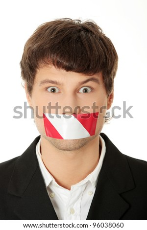 Freedom of speech concept. Young handsome businessman with red and white tape on his mouth. Isolated on white - stock photo