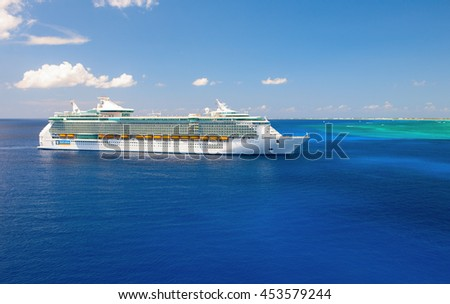 FREEDOM OF THE SEAS, ROYAL CARIBBEAN INTERNATIONAL - 03 APRIL 2008: giant luxury cruise ship is tendered next to Grand Cayman island. Caribbean sea.