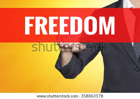 Freedom word Business man touch on red tab virtual screen for business bright concept - stock photo