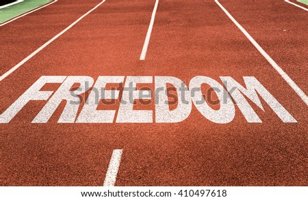 Freedom written on running track