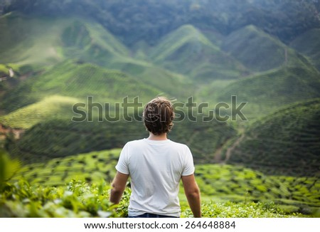 freedom young man in mountains - stock photo
