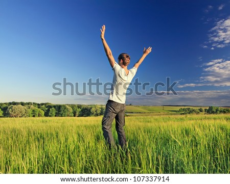 Freedom young man relax on a nature field - stock photo