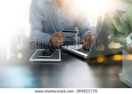 freelance man using laptop and holding credit card with as Online shopping concept - stock photo