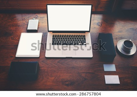 Freelancer needs workstation with accessories and cup of coffee, open laptop computer and digital tablet with blank copy space screen for text information or content, on-line learning or distance work - stock photo