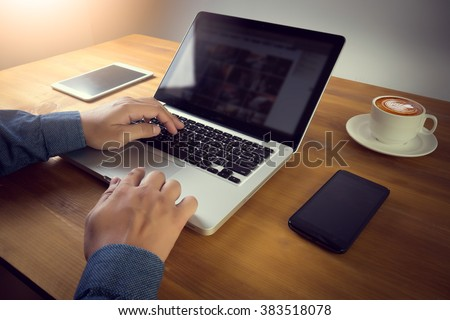 Freelancer needs workstation with accessories and cup of coffee, open laptop computer and digital tablet with blank screen, on-line learning or distance work, modern student table with copy space - stock photo
