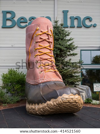 FREEPORT, MAINE, USA-AUG 31st, 2014: L.L. Bean is retail company founded in 1912 by Leon Leonwood Bean. A replica of its famous boot stands outside the flagship store. - stock photo