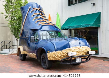 FREEPORT, MAINE, USA-AUG 31st, 2014: L.L. Bean was founded in 1912 by Leon Leonwood Bean. A replica of its famous boot has been converted to a promotional vehicle and stands outside the flagship store. - stock photo